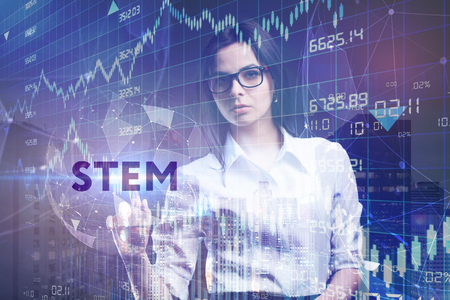 The concept of business, technology, the Internet and the network. A young entrepreneur working on a virtual screen of the future and sees the inscription: STEM Stock Photo