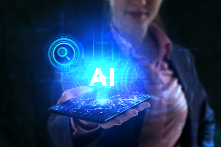 The concept of business, technology, the Internet and the network. A young entrepreneur working on a virtual screen of the future and sees the inscription: AI Stock Photo