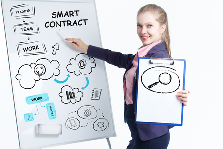Business, technology, internet and networking concept. Young entrepreneur showing keyword: Smart contract Stock Photo