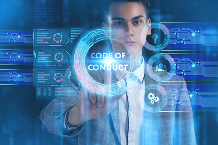 The concept of business, technology, the Internet and the network. A young entrepreneur working on a virtual screen of the future and sees the inscription: Code of conduct 版權商用圖片