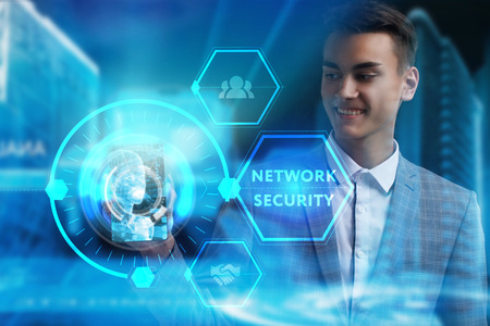 The concept of business, technology, the Internet and the network. A young entrepreneur working on a virtual screen of the future and sees the inscription: Network security Фото со стока