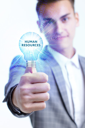The concept of business, technology, the Internet and the network. A young entrepreneur working on a virtual screen of the future and sees the inscription: Human resources Zdjęcie Seryjne