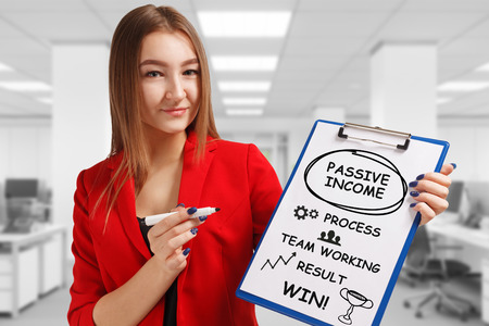 Business, technology, internet and networking concept. Young entrepreneur showing keyword: Passive income Stockfoto