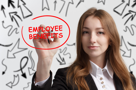 Business, technology, internet and networking concept. Young entrepreneur showing keyword: Employee benefits Stock Photo