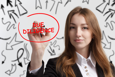 Business, technology, internet and networking concept. Young entrepreneur showing keyword: Due diligence
