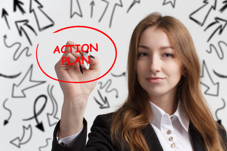 Business, technology, internet and networking concept. Young entrepreneur showing keyword: Action plan