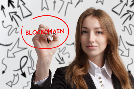 Business, technology, internet and networking concept. Young entrepreneur showing keyword: Blockchain