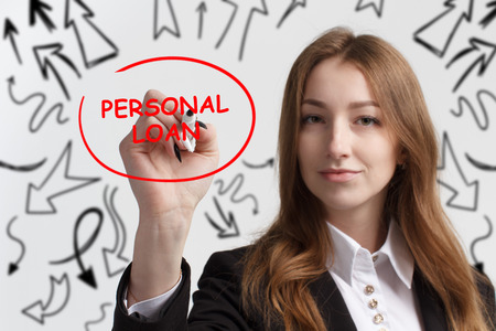 Business, technology, internet and networking concept. Young entrepreneur showing keyword: Personal loan Stock Photo