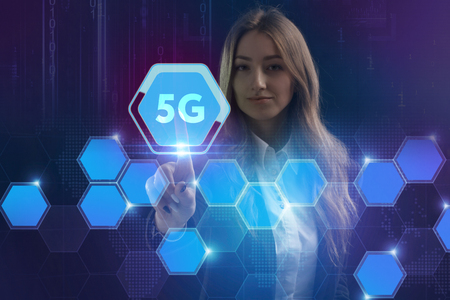 The concept of business, technology, the Internet and the network. A young entrepreneur working on a virtual screen of the future and sees the inscription: 5G