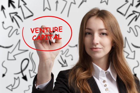 Business, technology, internet and networking concept. Young entrepreneur showing keyword: Venture capital Stock Photo