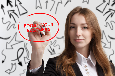 Business, technology, internet and networking concept. Young entrepreneur showing keyword: Boost your business Stock Photo