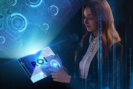 The concept of business, technology, the Internet and the network. A young entrepreneur working on a virtual screen of the future and sees the inscription: ROI