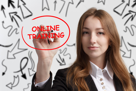 Business, technology, internet and networking concept. Young entrepreneur showing keyword: Online training Stock Photo
