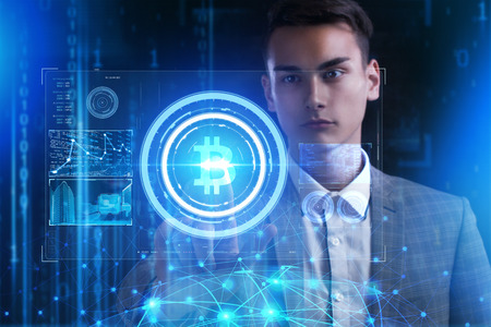 The concept of business, technology, the Internet and the network. A young entrepreneur working on a virtual screen of the future and sees the inscription: bitcoin