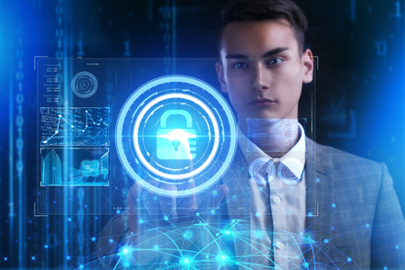 The concept of business, technology, the Internet and the network. A young entrepreneur working on a virtual screen of the future and sees the inscription: security lock Reklamní fotografie