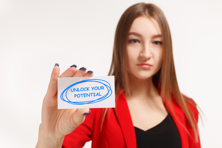 Business, technology, internet and networking concept. Young entrepreneur showing keyword: Unlock your potential Фото со стока