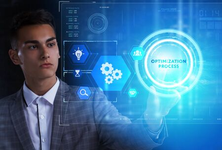 The concept of business, technology, the Internet and the network. A young entrepreneur working on a virtual screen of the future and sees the inscription: Optimization process 스톡 콘텐츠 - 124986021