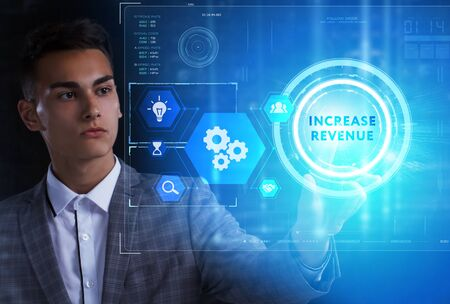 The concept of business, technology, the Internet and the network. A young entrepreneur working on a virtual screen of the future and sees the inscription: Increase revenue 스톡 콘텐츠 - 124986049