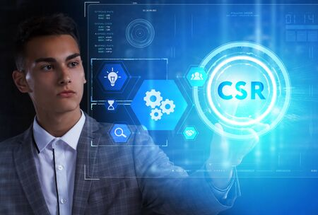 The concept of business, technology, the Internet and the network. A young entrepreneur working on a virtual screen of the future and sees the inscription: CSR 스톡 콘텐츠 - 124986113