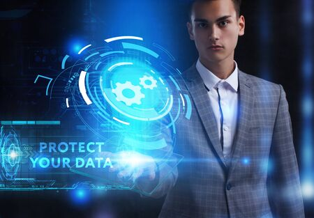 The concept of business, technology, the Internet and the network. A young entrepreneur working on a virtual screen of the future and sees the inscription: Protect your data Фото со стока