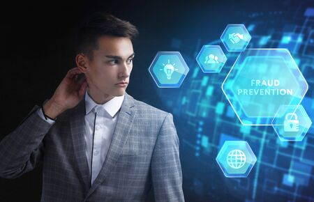 The concept of business, technology, the Internet and the network. A young entrepreneur working on a virtual screen of the future and sees the inscription: Fraud prevention Фото со стока