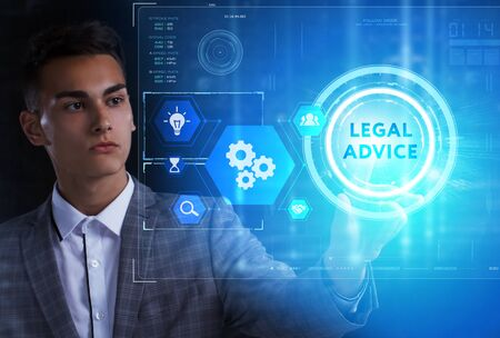 The concept of business, technology, the Internet and the network. A young entrepreneur working on a virtual screen of the future and sees the inscription: Legal advice Foto de archivo
