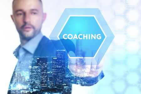 The concept of business, technology, the Internet and the network. A young entrepreneur working on a virtual screen of the future and sees the inscription: Coaching
