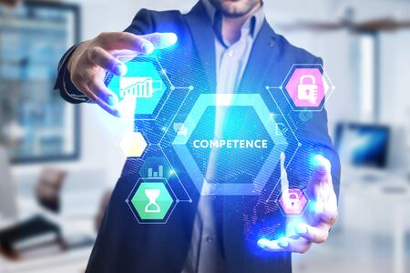 The concept of business, technology, the Internet and the network. A young entrepreneur working on a virtual screen of the future and sees the inscription: Competence Stock fotó