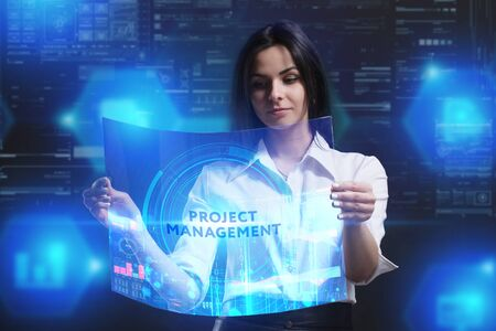 The concept of business, technology, the Internet and the network. A young entrepreneur working on a virtual screen of the future and sees the inscription: Project management