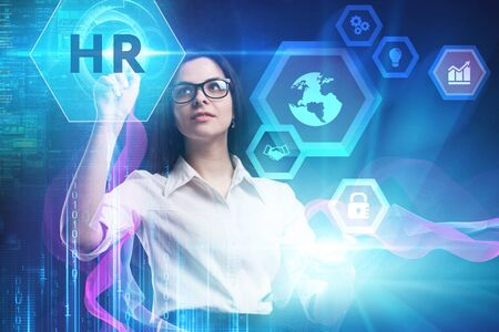 The concept of business, technology, the Internet and the network. A young entrepreneur working on a virtual screen of the future and sees the inscription: HR Stock fotó