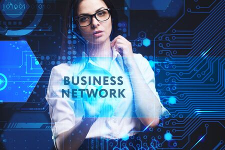 The concept of business, technology, the Internet and the network. A young entrepreneur working on a virtual screen of the future and sees the inscription: Business network Фото со стока