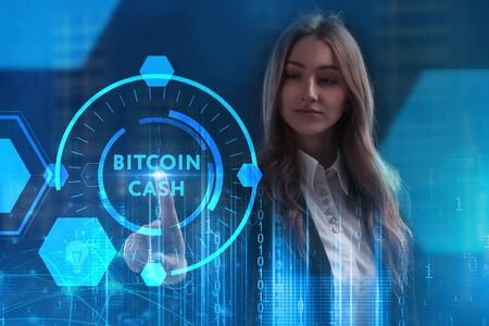 The concept of business, technology, the Internet and the network. A young entrepreneur working on a virtual screen of the future and sees the inscription: Bitcoin cash
