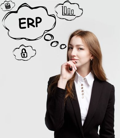 Technology, internet and network. A young entrepreneur is thinking how to become successful and protect your business: ERP 免版税图像