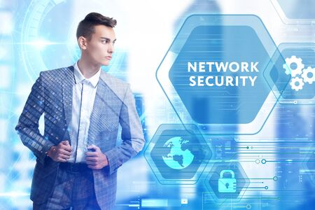 The concept of business, technology, the Internet and the network. A young entrepreneur working on a virtual screen of the future and sees the inscription: Network security