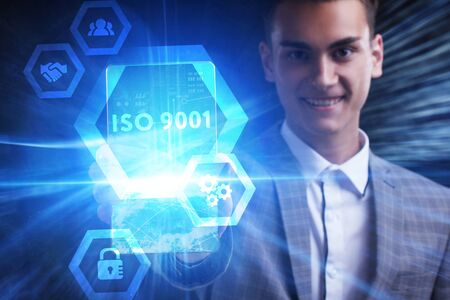 The concept of business, technology, the Internet and the network. A young entrepreneur working on a virtual screen of the future and sees the inscription: ISO 9001 版權商用圖片