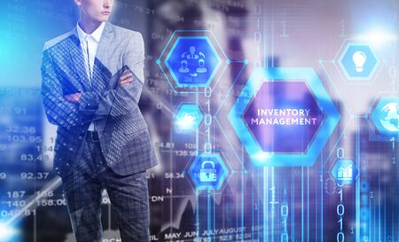 The concept of business, technology, the Internet and the network. A young entrepreneur working on a virtual screen of the future and sees the inscription: Inventory management