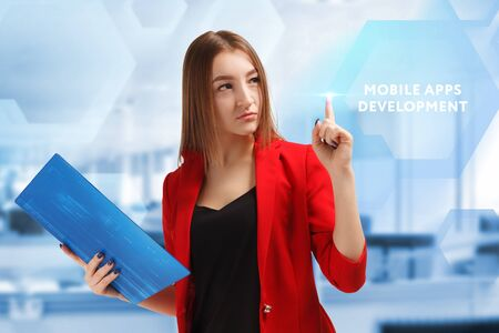 The concept of business, technology, the Internet and the network. A young entrepreneur working on a virtual screen of the future and sees the inscription: Mobile apps development Stockfoto