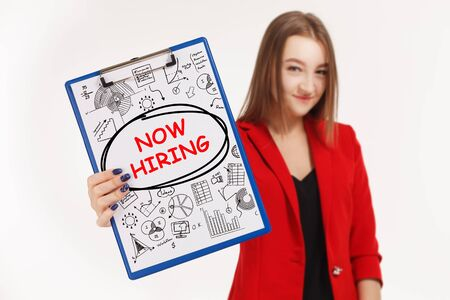 Business, technology, internet and networking concept. Young entrepreneur showing keyword: Now hiring
