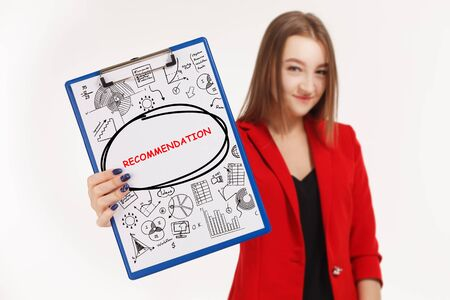 Business, technology, internet and networking concept. Young entrepreneur showing keyword: Recommendation