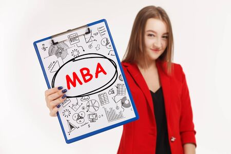 Business, technology, internet and networking concept. Young entrepreneur showing keyword: MBA