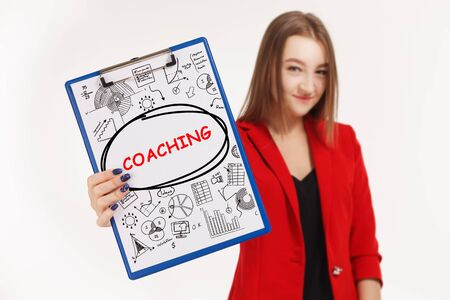 Business, technology, internet and networking concept. Young entrepreneur showing keyword: coaching Stockfoto