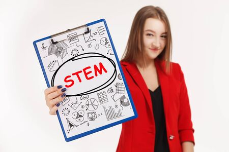 Business, technology, internet and networking concept. Young entrepreneur showing keyword: STEM
