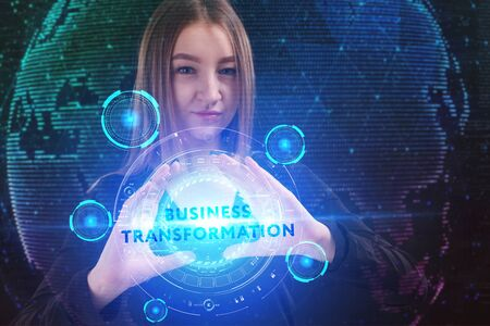 The concept of business, technology, the Internet and the network. A young entrepreneur working on a virtual screen of the future and sees the inscription: business transformation Zdjęcie Seryjne