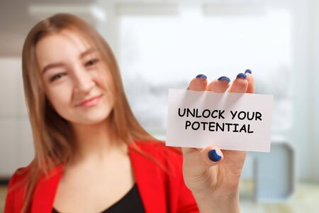 Business, technology, internet and networking concept. Young entrepreneur showing keyword: Unlock your potential Stockfoto