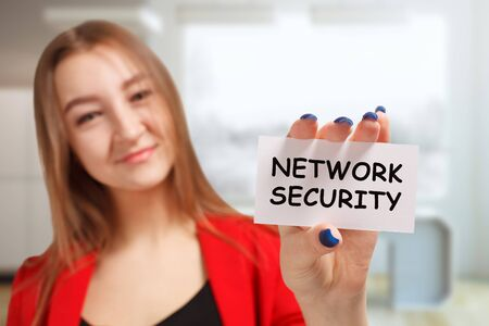 Business, technology, internet and networking concept. Young entrepreneur showing keyword: Network security Stok Fotoğraf