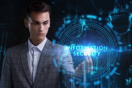 The concept of business, technology, the Internet and the network. A young entrepreneur working on a virtual screen of the future and sees the inscription: Information security Stock Photo - 129861353