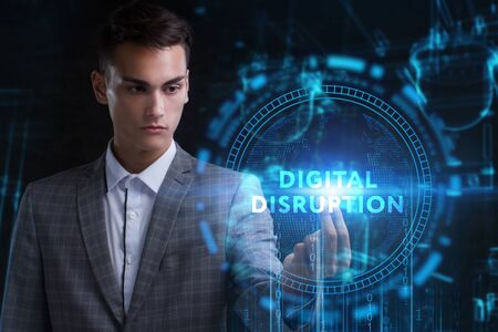 The concept of business, technology, the Internet and the network. A young entrepreneur working on a virtual screen of the future and sees the inscription: digital disruption Stock Photo - 129860792