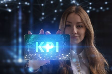 The concept of business, technology, the Internet and the network. A young entrepreneur working on a virtual screen of the future and sees the inscription: KPI