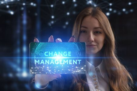 The concept of business, technology, the Internet and the network. A young entrepreneur working on a virtual screen of the future and sees the inscription: Change management Reklamní fotografie