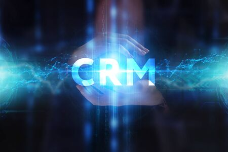 The concept of business, technology, the Internet and the network. A young entrepreneur working on a virtual screen of the future and sees the inscription: CRM